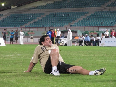 Diego Maradona taking a break at halftime; away from everyone