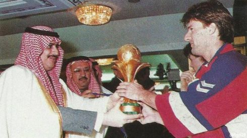Prince Sultan Bin Fahd Bin Abdulaziz hands the trophy of the 1995 Confederations Cup  to Denmark's captain Michael LAUDRUP
