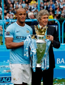 Vincent Kompany and Manuel Pellegrini with the English Premier League Trpphy